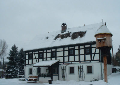 Pension Holzwurm Fachwerk im Winter